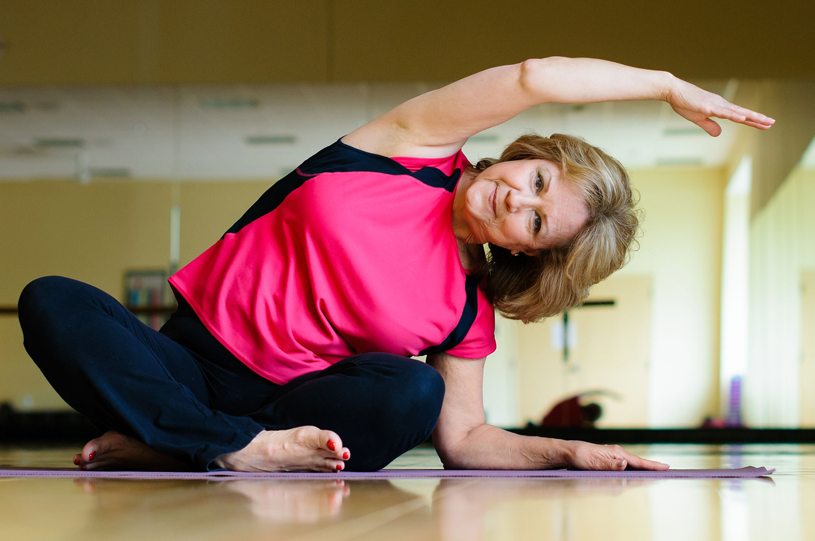 stock-photo-mature-woman-does-yoga-side-bend-107200553